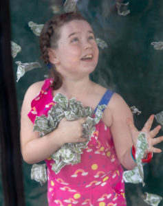 """Mickayla grabs the """"money"""" as St. Mary's Octoberfest. She turned in her """"money"""" for prizes, including a stuffed dog for her brother, Teddy,4. Photos/Jerry Callaghan"""
