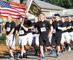 Representatives from the Worcester County Sheriff's Office Basic Recruit Training Academy #44 begin the road race.