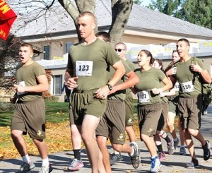 Led by Chief Warrant Officer 3 Randolph P. Mann (front), cadets of the Marine Corps Junior Reserve Officer Training Corps at Assabet Valley Regional Technical High School in Marlborough begin the road race.