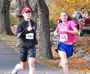 Nearing the finish line are Stephanie Cummings of Berlin and first-place female Holly Hruskoci of Shrewsbury.
