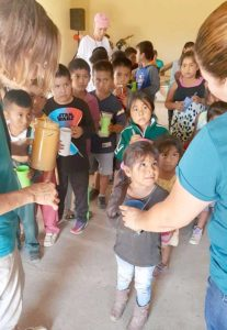 Mary Ann Judson helps with outreach work, feeding kids a snack in towns surrounding the mission. Photo/submitted