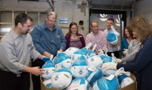 Officials from the Worcester County Food Bank and Stop & Shop admire turkeys donated to the food bank.