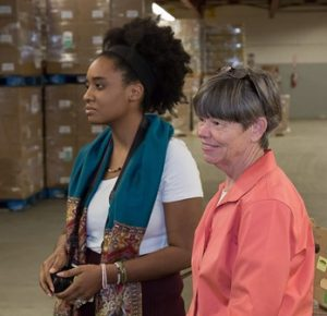 Aliya Ewing, communications manager (l) and Jean McMurray, executive director of the Worcester County Food Bank watch as 1,000 turkeys arrive from Stop & Shop.
