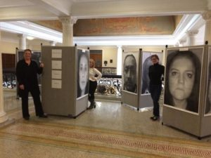 "Advocates make a stand during the ""Massachusetts: Face Workplace Bullying"" exhibit. Shrewsbury resident Deb Falzoi's enlarged face shot is shown on the last canvas on the right. (Photo/submitted)"