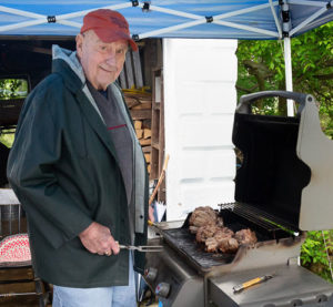 Bob Sargent grills tenderloin for his guests. Photo/Jerry Callaghan