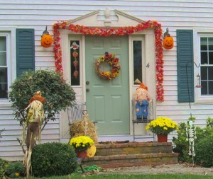 Scarecrows, pumpkins and garlands make for a colorful street scene.