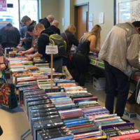 Patrons peruse the many offerings at the Friends of the Shrewsbury Public Library's Annual Used Book Sale April 5. Hundreds of visitors of all ages took the opportunity April 5-8 to stock up on their reading materials. Photo/Heidi Hayes-Pandey