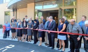 State and local officials, as well as members of the Shrewsbury Public Library staff and board of directors celebrate the official grand opening of the renovated building.