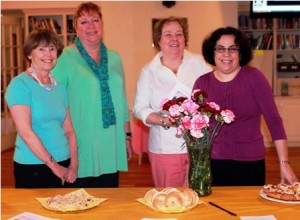 ( l to r) Sue Bourget, Rev. Lynne Dolan, Stephanie Ambra, and Carol Anne Geary pose by the breakfast table.