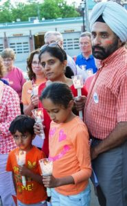 The Chhabra family, (l to r) Suveer, Arpan, Roop and Vikram, participate in the prayer vigil at the First Congregational Church.
