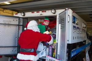 Charlie Pratt gives a hand to Santa.