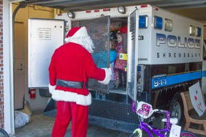 """Santa pretends to """"lock up"""" (l to r) Maddie Faucher, 6, Griffin Faucher, 4 and Julianna Flores, 5."""