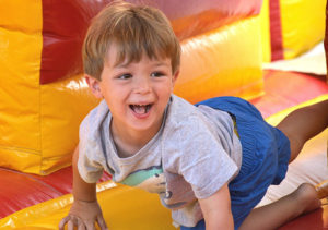 Colin Cammuso, 4, plays on an inflatable obstacle course. Photos/Ed Karvoski Jr.