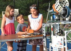 Learning basic engineering from Algonquin Robotics Team are Sienna Laurie, 8, Grace Androki, 8, and her brother Dean, 5. Photos/Ed Karvoski Jr.