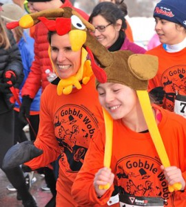 Debbie Simon and her daughter Emma, 11, sport matching turkey hats.