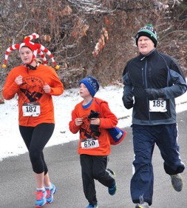 Noah LaBelle, 9 (center), runs along with Kasey Wagner and her father Joe.