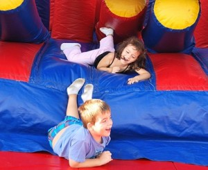 Tumbling out of an inflatable maze are the Heisler siblings: Katrina, 4, and Jacob, 6.