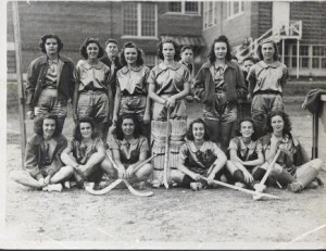 The girls' field hockey team outside of Major Howard W. Beal Memorial High School.