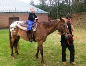 Carson McGrath, now a first-grader, rides a pony led by a representative from Ridge Valley Stables at last year's Fun Fair to benefit the North Grafton Elementary Schools Parent Teacher Group.