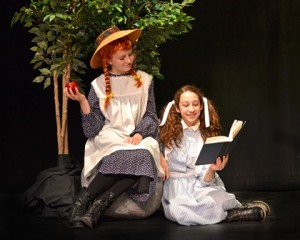"""Lindsey Spuria as Anne (left) and Veronica Boure as Diana in Hudson High School's production of """"Anne of Green Gables."""" Photo/submitted"""