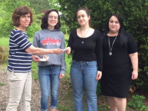 Longtime Hudson Garden Club member Irene Cunha presents two of the club's scholarships to her granddaughters, Amelia (center left) and Antonia Massinger, while their mother, Marianne Massinger, looks on. Photos/submitted