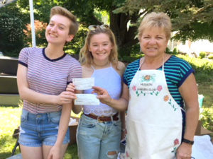 Photo 2: Maddison Cocca (left) and Josie Saliga (center) are presented their Hudson Garden Club scholarships by its President Patricia Main. Photos/submitted