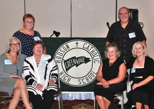 "Gathered at the Hudson Catholic High class of 1965's 50-year reunion with an authentic ""Green Wave"" banner is the planning committee: (back, l to r) Barbara Jagling Richards and Larry Letendre, co-chairs, (front, l to r) Joy Tarbell, Carol Cennedella Quinn, Anne Ordway Wifholm and Mary Conley Lamburn. Not pictured is Nancy Kelly Burbank. (Photo/Ed Karvoski Jr.)"