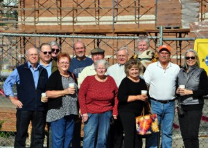 Visiting the construction site where their alma mater Hudson Catholic High was recently demolished are class of 1965 alumni (back, l to r) Roger Lamy, Tom Garrity, Mike Bourque, Larry Letendre, Peter Keough, Joe Stankus, Frank Finnerty with his dog Bubba, Ken Giardina, Joy Tarbell, (front, l to r) Barbara Jagling Richards, Barbara Martin Colley and Ann Ordway Wifholm. (Photo/Ed Minyard)