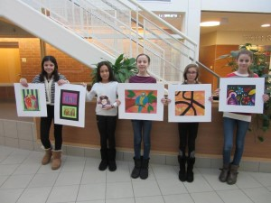 (l to r) Sixth-grader Loralyn DiDucca, fifth-graders Sara Horton and Chloe Mazza, sixth-grader Gabie Flood, and seventh-grader Alyssa Bowler show off artwork done in Diane Hoff's art class. (Photo/submitted)