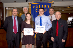 (l to r) Brian Regan, Hudson High School principal; Greg Parker, president of the Hudson Rotary Club; Samantha Johnson; Devon Hassan; Mark Hollick, Assabet Valley Regional Technical High School principal; and Rotarian Ed Soave. (Photo/submitted)