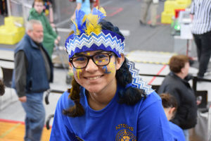 Isla Soberanis, a Hudson sophomore on the Assabet Valley Regional Technical High School's robotics team, sports her team colors and school spirit in the viewing stands at the recent robotics competition in Bridgewater. Photos/Cindy Zomar
