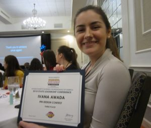 Ivana Awada received third place out of 17 submissions for the creation of her pin design.
