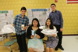 Ninth graders (l to r) Daniel Pereira, Kelin Lopez, Sheyla Rosales and Andrew Buroni display their group's capsule and hovercraft prototypes.