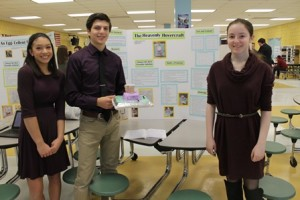 (l to r) Kimberly, Matthew and Eliana display their project, The Heavenly Hovercraft.