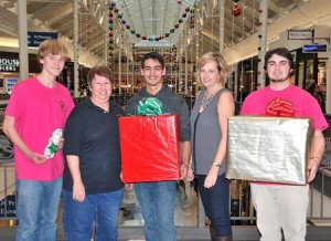 Ready to gift wrap Dec. 6, the first day of the fundraiser at Solomon Pond Mall, are Marlborough Public Schools Music Association members: (l to r) Austin Turner, senior; Marlene Manell; president; Shawheen Fagan, senior; Valarie Steinman, board member and concession chair; and Connor Bailey, senior. Photo/Ed Karvoski Jr.