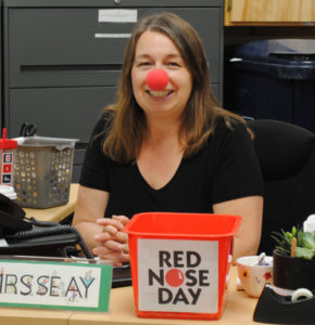 Administrative Assistant Sally Shea gets in the spirit of Red Nose Day.