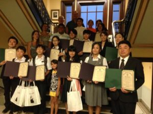 A group of students and faculty members from Akiruno, Japan are welcomed to Marlborough at the July 25 City Council meeting.  They were presented with citations and gifts from Mayor Arthur Vigeant and City Council President Edward Clancy. A member of the teaching staff of Marlborough Public Schools, Nancy Klein, organizes the event which has been held for the past several years.