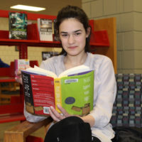 "Jacquelyn Dillon with King's book, ""Please Ignore Vera Dietz"". Photos/submitted"