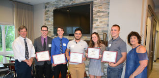Darren McLaughlin, president of the Marlborough Regional Chamber of Commerce Community Foundation, and Susanne Morreale Leeber, president and CEO of the Chamber, award scholarships to five recent high school graduates: (l to r) Bradford Connor and Michael Cuddy, both from Hudson High School; Igor DeMoraes and Julia Lambert, both from Marlborough High School; and William Soto, from Assabet Valley Regional Technical High School. Photo/Cindy Zomar