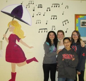 Melican Middle School students who are working to complete a mural in Lisa Kaplan's memory: (l to r) Kaitlyn Wilber, Alana Weiner, Kimiko Clark, and Kayla Alvers.