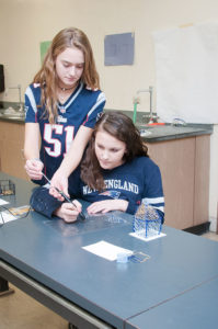 Melican Middle School students, Taylor Mayo (standing) and Emma Gorham, work together to create their one-dimensional scientific concepts into three-dimensional prototypes with 3Doodlers.