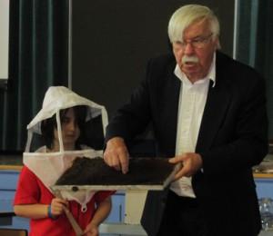 Marion E. Zeh School student with Worcester County Beekeepers Association Program Director Ken Warchol.