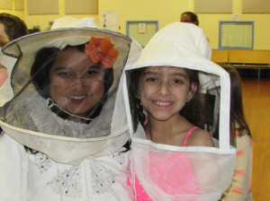 Marion E. Zeh School students try on beekeeper equipment. (Photos/submitted)