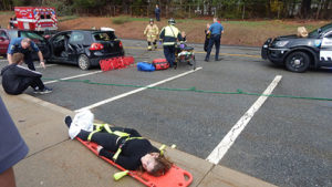 ARHS students and first responders role play during a mock accident to illustrate effects of marijuana and alcohol on driving.Photos/Melanie Petrucci