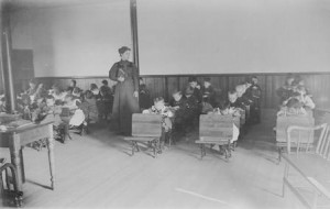 Students working at their desks in the Factory School.