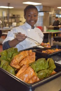 Najara Saint Paul from Marlborough serves a taco salad in homemade shells. (Photo/submitted)
