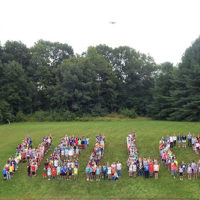 "Neary Elementary School students pose to form the letters of the word ""Hello"" Photo/Melanie Petrucci"
