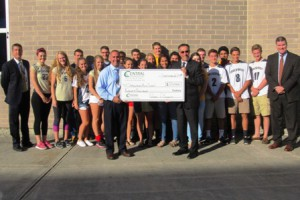 Accompanied by student athletes, SHS Athletic Director Jason Costa, (front, left) accepts a donation of $20,000 from David L'Ecuyer, the president and CEO of Central One Federal Credit Union.  SHS Principal Todd Bazydlo is in the back row, far left and Shrewsbury Superintendent Dr. Joseph Sawyer is far right.  Photo/Bonnie Adams