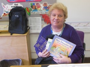 Beal School Nurse Jill Wensky holds the contents from an information backpack. (Photo/Nance Ebert)