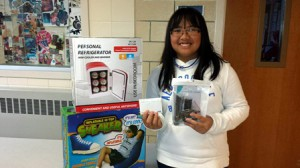 Oak Middle School student Kimmy Chhoeuk with her prizes (Photo/Heidi Hayes-Pandey)